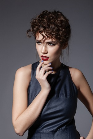sexy fashion: Fashion portrait of young sexy woman with hairstyle posing on grey background Stock Photo