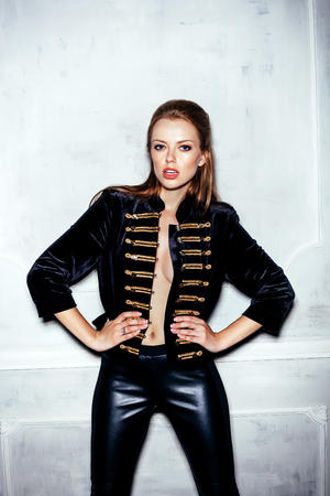 hussar: Fashion portrait of young sexy woman with hairstyle wearing vintage military hussar uniform Stock Photo