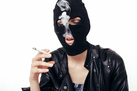 gangster girl: Cool girl in balaclava smoking cigarette