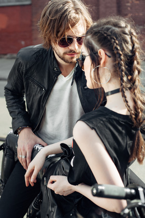 urban fashion: Couple in love. Bikers and vintage custom motorcycle. Outdoor lifestyle portrait