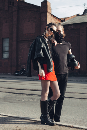 urban fashion: Outdoor lifestyle portrait of loving man and woman Stock Photo