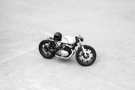 rebuilt: Silver rebuilt motorcycle motorbike cafe-racer is parked alone. Wild lifestyle. View from above
