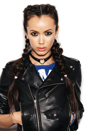 Young woman with Healthy Long Hair Braid wearing black leather jacket. Portrait of biker girl over white background not isolated