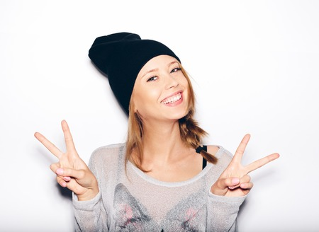 young woman in black beanie . White background, not isolated Stock Photo