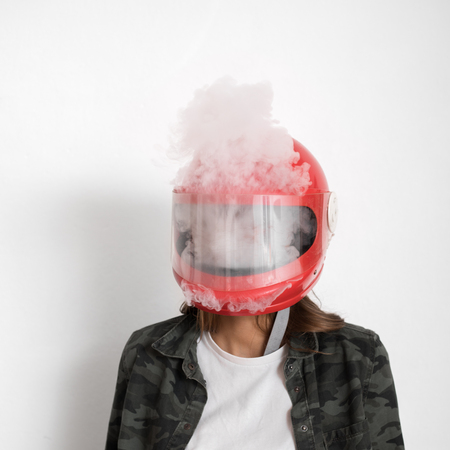 person wearing helmet, smoking. Steam or vapor inside and out. Mood: lost patience, too much effort, boiling point, pain