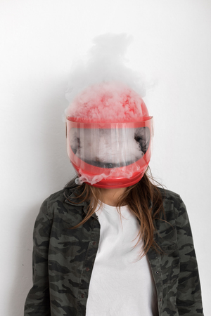 lots of vapor or steam or smoke inside and out the helmet. Atmosphere is about loosing control, anger, boiling inside, high emotions, reaching top of them Stock Photo