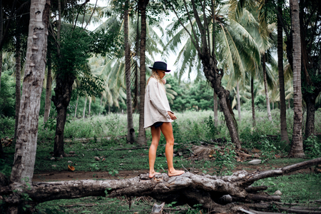 Beautiful girl in tropical forest