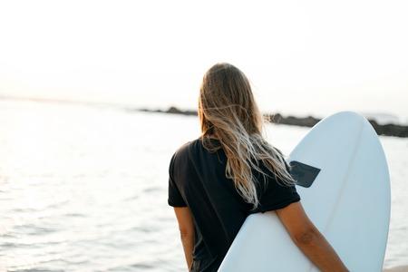 Surfer girl on beach