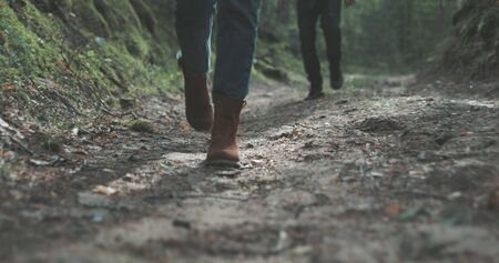 Young man and woman hiking in forest. Hiker camping in woods. Tourist couple walking by stream. Stock fotó