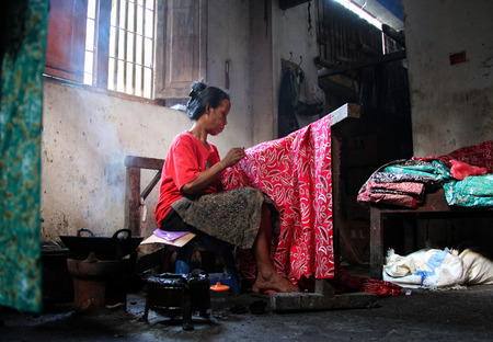 A woman making traditional batik cloth at home Editöryel