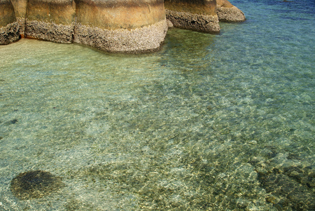 rock formation: Natural granite rock formation in the clearly beach