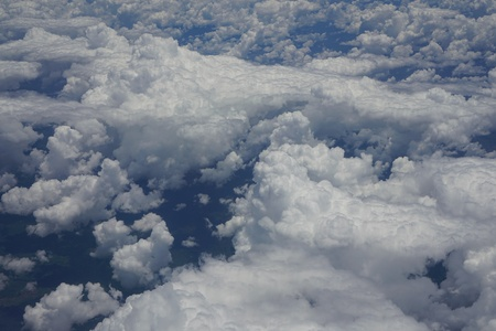 View of the sky and the blue sea from the plane's window