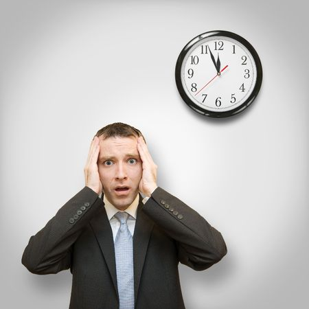 scared businessman and clock behind photo