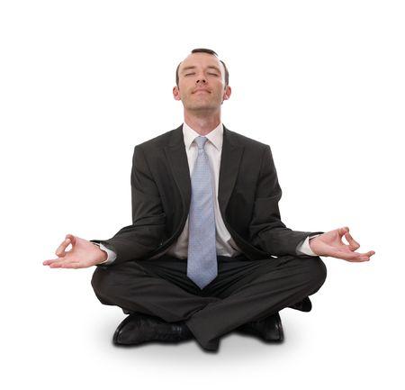 relaxed businessman meditating isolated on white photo