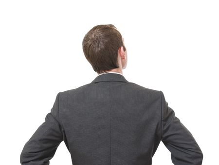 looking behind: back of pensive businessman looking up isolated on white background Stock Photo