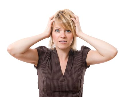 anguished: scared businesswoman with hands on the head isolated on white background
