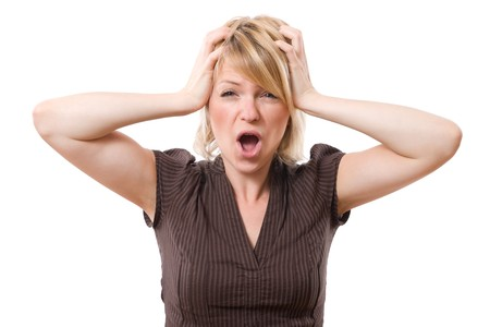 scared woman screaming with hands on the head isolated on white background photo