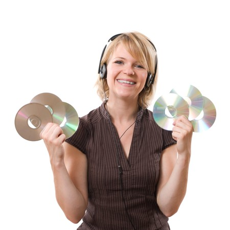 happy woman listening music with cds in the hands photo