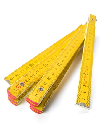 wooden metre: yellow folding rule isolated over white background