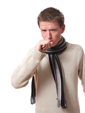 enfermo: joven enfermo con bufanda tos aislados sobre fondo blanco Foto de archivo