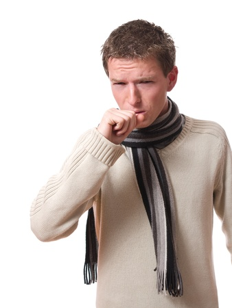 coughing: young ill man with scarf coughing isolated over white background
