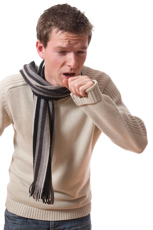 sneeze: young ill man with scarf coughing isolated over white background