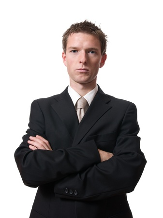 empresario enojado: Empresario enojado con los brazos cruzados aisladas sobre fondo blanco Foto de archivo
