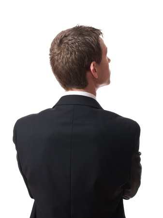 back up: back of pensive young businessman looking up isolated on white background Stock Photo