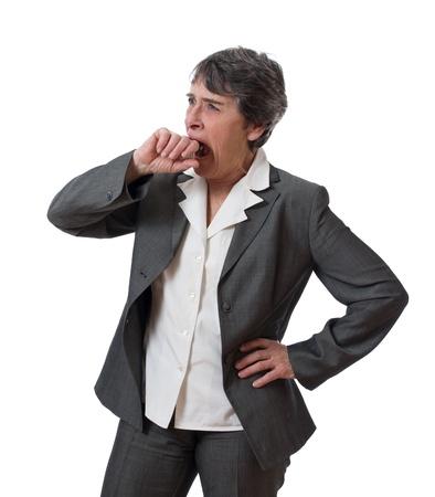 mature businesswoman yawning isolated on white background photo