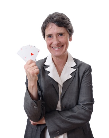 happy mature lady showing four aces isolated on white background Stock Photo - 9618123