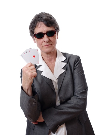 serious mature lady showing four aces isolated on white background Stock Photo - 9618125