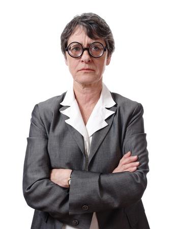 persona enojada: Empresaria enojada con gafas aisladas sobre fondo blanco Foto de archivo
