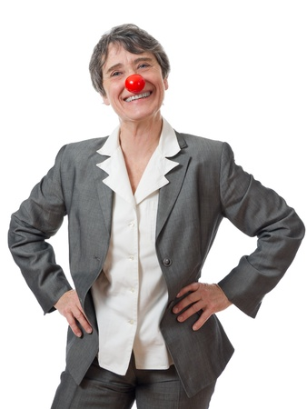 ridiculous: mature lady with red nose smiling on white background
