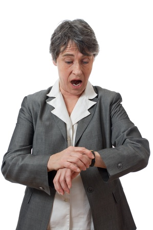 anguished: expression of late lady looking at her watch on white background