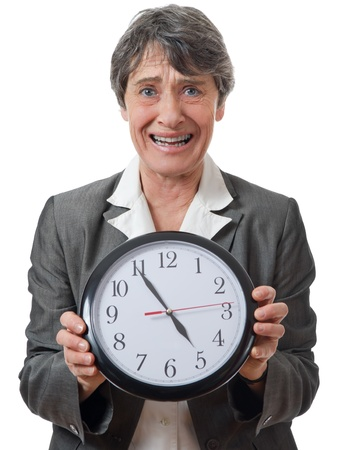 anguished: expression of late lady holding a faceclock on white background