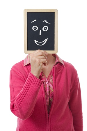 fake: woman hiding her face behind a slate