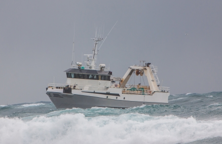 Icelandic offshore commercial stern trawler in heavy sea off the coast of Iceland Stock Photo