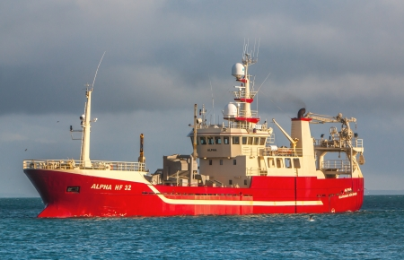 Icelandic offshore commercial pelagic fishing vessel off the coast of Iceland Editorial