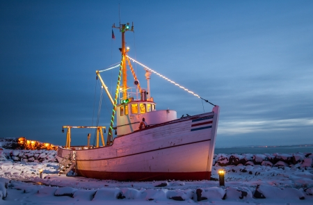 Old Icelandic fishing boat built in 1960 now used as a display piece near the marina in Keflavik, Iceland  photo