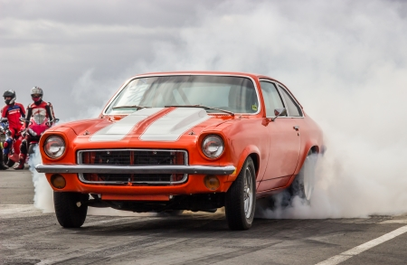 Iceland - June 29, 2013   Orange colored 1973 Chevrolet Vega at drag racing event