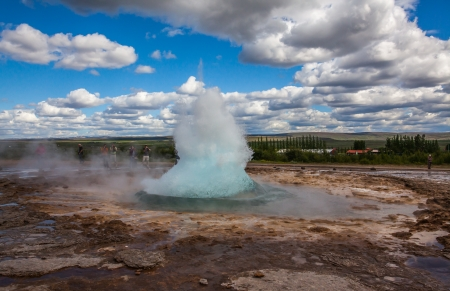 natural landmark: Iceland - June 30, 2012    Geysir  Strokkur  famous Icelandic natural landmark erupting with tourist all around