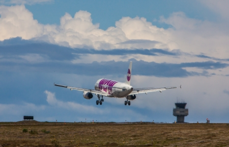 kef airport. keflavik, iceland - june 19, 2013 airbus a320 from wow air approaching kef airport kef