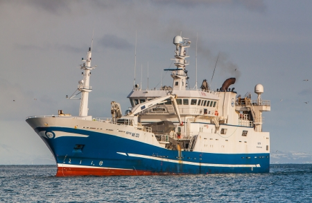 Helguvik, Iceland - March 03, 2012   Pelagic fishing vessel 2730 Beitir NK-126 approaching port in Helguvik, Iceland   Stock Photo - 25182598