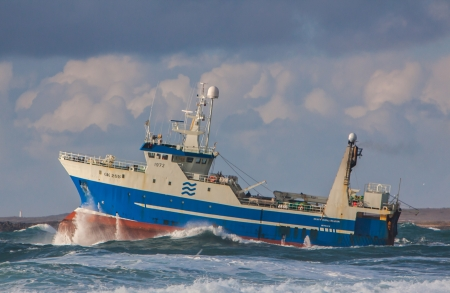 grindavik: Iceland - March 03, 2012   Icelandic stern trawler heading to open sea from the fishing village Grindavik, Iceland
