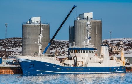 Helguvik, Iceland - February 17, 2012    Pelagic fishing vessel 1923 Birtingur NK-124 unloading Capelin to fishmeal plant    Stock Photo - 25182605