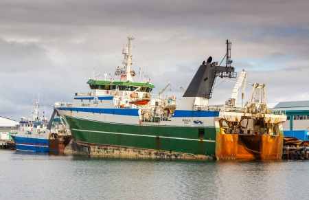 Reykjavik, Iceland - May 10, 2012     Image from Reykjavik harbour where two trawlers lie by the docks  Stock Photo - 25455099