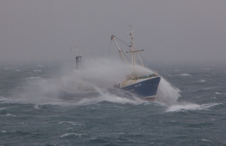 Iceland - November 14, 2011   Icelandic fishing boat Happasaell KE-94 in heavy sea