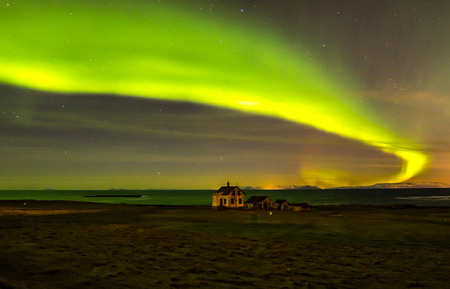 iceland: Northern lights above abandoned house in Iceland