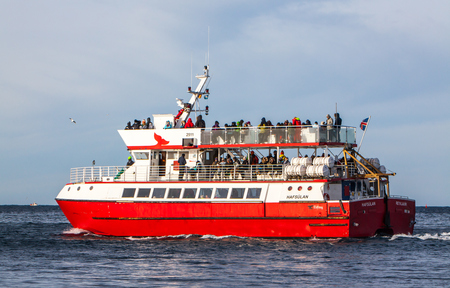 Iceland - February 24, 2014   Whale watching boat from Reykjavik in excursion with the tourists