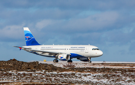 airways: Keflavik, Iceland - March 30, 2015 : Airbus A-319 from Atlantic Airways at Kef airport in Iceland